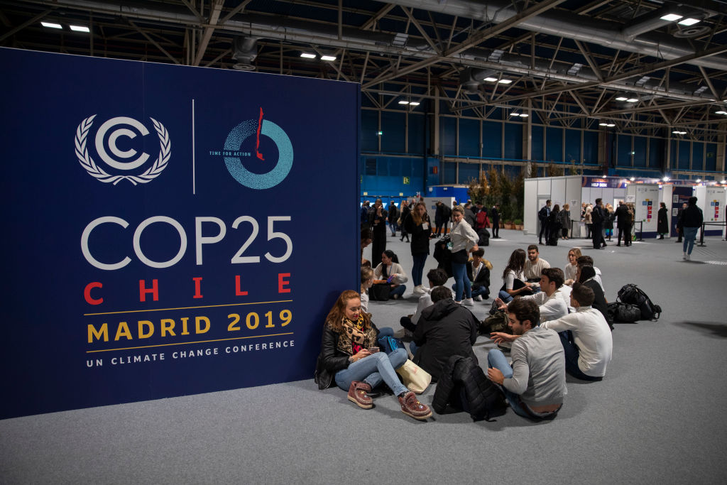 MADRID, SPAIN - DECEMBER 02: People sit on the ground during the opening day of the UNFCCC COP25 climate conference on December 2, 2019 in Madrid, Spain. The conference brings together world leaders, climate activists, NGOs, indigenous people and others together for two weeks in an effort to focus global policy makers on concrete steps for heading off a further rise in global temperatures. (Photo by Pablo Blazquez Dominguez/Getty Images)