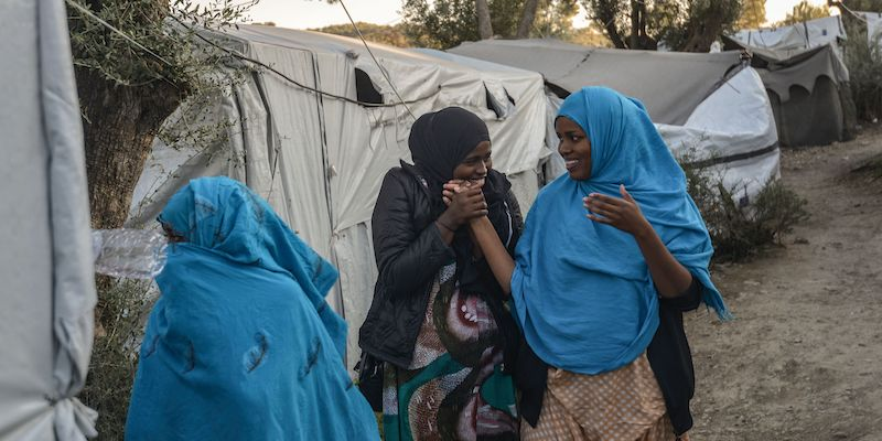 Women stand in a camp outside the refugee camp of Moria, in the northern Greek island of Lesbos on September 25, 2018. - But despite a 2016 agreement between Turkey and the European Union designed at shutting down this particular route into Europe, the migrants are continuing to arrive. About 20,000 refugees and migrants - more than 8,000 of them for the only camp of Moria, with a capacity of 3,000 places - have been confined in Lesbos for months. Most fo them are qualified for passage to Greece. (Photo by Aris MESSINIS / AFP) (Photo credit should read ARIS MESSINIS/AFP/Getty Images)